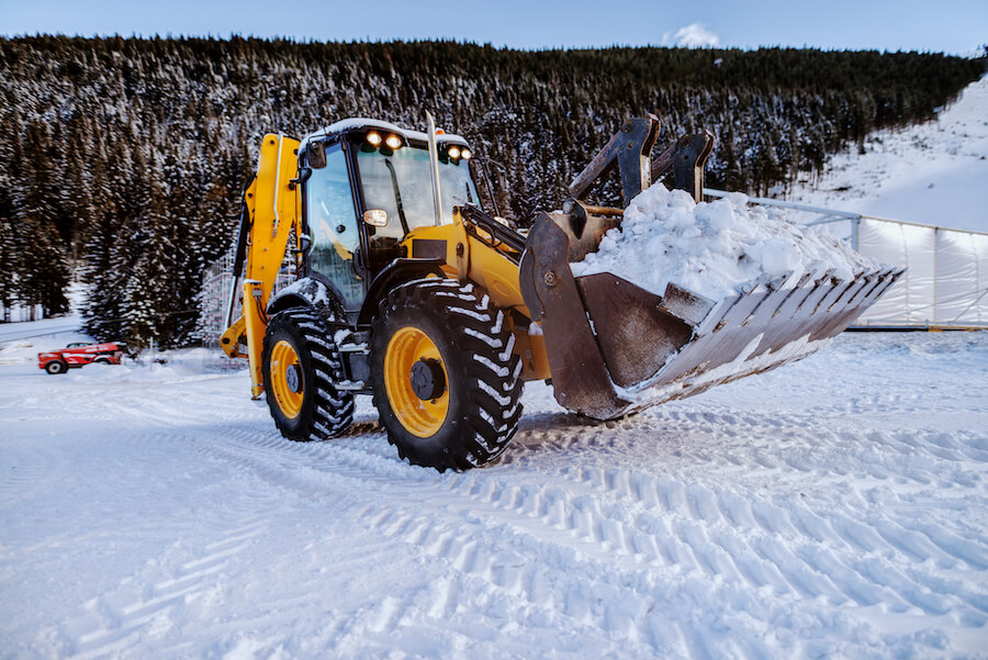Bulldozer cleaning snow